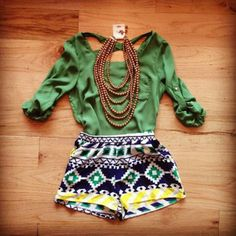 I love this pair if tribl print shorts paired with a classy top and a statement necklace.
