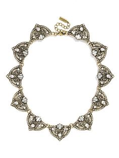 This gorgeous futuristic-meets-art-deco motif features crystal-embellished shields for an all-around dose of intricate sparkle. #baublebar #swatstyle #statement #necklace