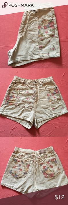Tan high waisted vintage shorts w/ floral patches Vintage tan high waisted shorts floral patches on from and on pockets on back. Size 13, fits small, vintage sizing. Micheal G Shorts Jean Shorts