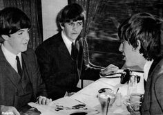 Paul, Ringo and George on the train