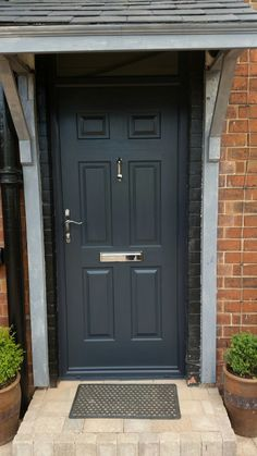 An elegant door in Grey including chrome swept handles, letterplate and doctor knocker. Installed in Carlton, Nottingham. Call us today to get a free quotation on 01158 see our website or come and visit us at our West Bridgford Showroom. Grey Upvc Doors, Black Front Doors, Garage Door Styles, Garage Door Design, Garage Doors, Victorian Front Doors, Victorian Terrace, Front Door Entrance, House Front Door