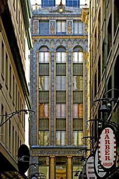 Majorca Building built 1928 – 1929. 258-260 Flinders Lane, corner Degraves Street. Spanish style Art-Deco building with complex mosaic tile work. Built in the Interwar period in the Neo-Gothic style, by Harry Norris, who also designed the Nicholas Building and Mitchell House.