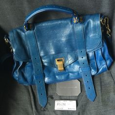 PS1 in Peacock Blue Effortlessly chic.  The most buttery leather evaaaa.  Was an absolute favorite of mine but recently bought a couple bags and need more closet space.  This is in moderately used condition with signs of wear as shown.  Mainly it's some water stains (not noticeable when wearing due to color) and some rubbing/wear on edges.  Inside is in good condition - no rips or stains.  Comes with original tags as shown and dustbag.  No offers accepted, price is firm.  Not included in…