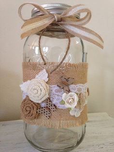 This is a one of a kind beautifully crafted mason jar vase. Fall inspired, It is wrapped in burlap and lace and finished off with burlap