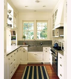 White cabinets, grey countertops, wood floor