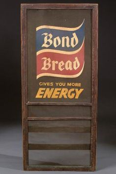 A BOND BREAD ADVERTISING SCREEN DOOR INSERT mid 20th century with applied logo and lettering on metal screen in wooden frame. 24 inches x 54 inches.
