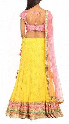Yellow and pink lehenga by Ritu Beri. This would look great for a mehendi ceremony or haldi if you don't get it dirty.