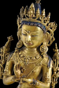 View 1: This exceptional, gilded, cast-copper alloy image of the bhodistattva Maitreya is especially beautiful and well proportioned. The bodhisattva is seated in bhadrasana with his legs draped over the front of the pedestal with the feet resting on a lotus support. He hands are in the dharmachakramudra posture ('turning the Wheel of Law').
