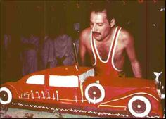 Not about to bite the dust just because he was turning 38, Freddie Mercury of the British rock group Queen chowed down instead on a five-foot-long birthday cake baked to look like a vintage Rolls-Royce. Mercury celebrated with a party for 500 friends at London's Xenon night club. Among the guests was John (Elephant Man) Hurt, 44, who chose the occasion to propose to American actress Donna Peacock, 37. Clearly, neither believes in wasting any time on long engagements: The next morning they…