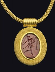 A ROMAN CARNELIAN RINGSTONE CIRCA LATE 1ST CENTURY B.C.-EARLY 1ST CENTURY A.D; mounted as a pendant in modern gold setting