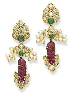 A PAIR OF RUBY, EMERALD AND DIAMOND EAR PENDANTS, BY CARTIER Of oriental motif, each detachable stylised palmette surmount set with a cluster of brilliant-cut diamonds and a circular-cut emerald, suspending a carved ruby leaf set between a similar motif, flanked by a pearl cluster, circa 1965
