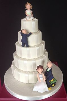 A novelty wedding cake including all the family