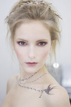 Love the soft yet edgy makeup and gorgeous romantic hair-the temp coco tattoo is nice as well :)