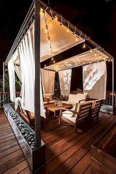 Infuse dramatic effect to this pergola by adding whimsical lights and light colored curtains. The wooden deck and furniture always add the charm. Pergola Swing, Pergola With Roof, Pergola Shade, Pergola Patio, Pergola Kits, Gazebo Ideas, White Pergola, Roof Terrace Design, Rooftop Design