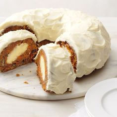 "Surprise Carrot Cake Surprise Carrot Cake Recipe -A cousin gave me this carrot cake recipe. It's a wonderful potluck pleaser with its ""surprise"" cream cheese center. My husband and our two young children love it, too! —Lisa Bowen, Little Britian, Ontario Köstliche Desserts, Delicious Desserts, Plated Desserts, Cake Surprise, Cake Recipes, Dessert Recipes, Cookbook Recipes, Dinner Recipes, Best Carrot Cake"