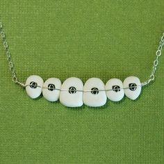 Braces/Orthodontics necklace. Dr. Tracht and Dr. Briskie Pediatric Dentistry | #RochesterHills | #MI | www.kidsgrins.com