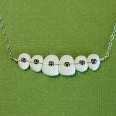 Braces/Orthodontics necklace. Dr. Tracht and Dr. Briskie Pediatric Dentistry | #RochesterHills | #MI | www.kidsgrins.com