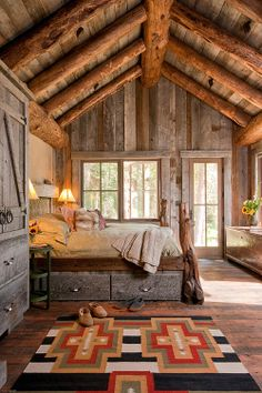 Incredible Rustic Bedroom Ideas In Vaulted Ceiling Design With Exposed Logs Combined With Striped Wooden Wall With Glass Windows