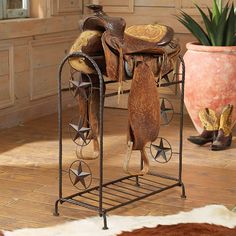 Lone Star Metal Saddle Stand - A Black Forest Decor Exclusive - Display a beloved saddle or heirloom quilts on this metal stand with star and wire details and a bottom shelf. Homer Decor, Westerns, Painted End Tables, Western Bedding, Black Forest Decor, Southwestern Decorating, Western Furniture, Recycled Furniture, Metal Crafts