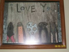 made this for my dad..old screws and gadgets hot glue gun and scrapbooking paper. not a great photo