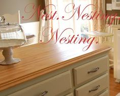 Moulding added to an inexpensive ($39) IKEA butcher block counter.  The finishing touch that makes this island look perfect!  Nest. Nesting. Nested.