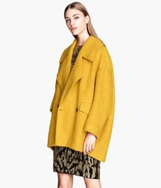 H&M - Wide, double-breasted coat in a soft, marled fabric containing some wool with front pockets with a flap, and a rounded hem that is slightly longer at the back. Lined.