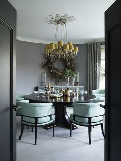 Hubert Zandberg Interiors designed this London pied-à-terre as a contemporary take on a traditional gentleman's club, and in the dining room, pale blue chairs by Soane surround a custom dark-wood table by Zandberg. Elegant Dining Room, Dining Room Design, Dining Room Furniture, Dining Rooms, Furniture Ideas, Interior Exterior, Home Interior, Luxury Interior, Bamboo Dining Chairs