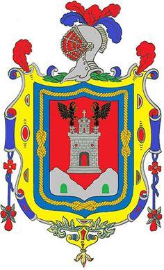 Escudo de la ciudad de Quito es el símbolo heráldico que representa a la ciudad desde el 14 de marzo de 1541.  Un castillo de plata metido entre dos cerros o peñas, con una cava al pie de cada uno de ellos de color verde, y encima de dicho castillo una cruz de oro con su pie verde que la tengan en las manos dos águilas negras grietadas de oro, la una a la mano derecha y la otra a la izquierda, puestas en vuelo, y por orla un cordón de San Francisco de oro en campo azul. Tomado de…