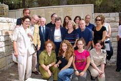 The family of Holocaust survivor Ehud Loeb with the grandchildren of his rescuer, Louise Roger at the wall of honor in Garden of the Righteous at the ceremony honoring  Louise Roger as Righteous Among the Nations in 2009