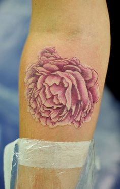 Peony tattoo idea. Either a lighter pink or maybe a light purple. And I would get it centered on the edge of my shoulder.