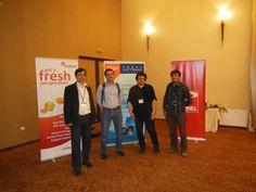 Myself, Mihai Tătăran, Tudor Damian and Marius Mornea - Today Software Magazine team and ITCamp organizers in front of TSM brand rollup.