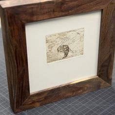 We framed this #intaglio print from @hillary_clary with reclaimed #walnut.  #art #framing #urbanashes @urbanashes #finelinesupply