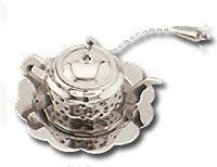 Tea Infuser - Teapot with Drip Tray , http://www.amazon.com/dp/B000NKWT2O/ref=cm_sw_r_pi_dp_IzcMqb1W601SX