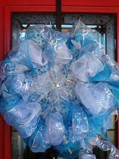 """Winter deco mesh wreath. (Would be cute with a """"Its A Boy"""" decoration instead of the snowflake)"""
