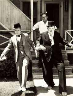 Laurel & Hardy with Harold  Roach, Gøg og Gokke, silent movie, black and white, photography, comedian, male, shoes, socks, bare foot, bowler, house, celeb, famous
