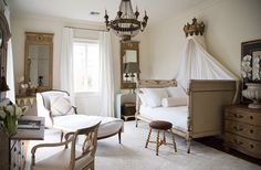 The guest room seems redolent of a French château, yet if you look closely, Tara has balanced the haute French design—the Directoire bed, the 19th-century chaise—with refreshing contemporary pieces like an opaque glass console.