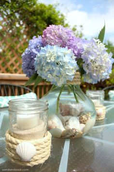 I like the simple flowers with water and shells at the bottom. No rope though and add variety in flowers.