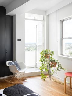 The home of Aaron Peters and Rebecca Pouwer in Brisbane's iconic Torbreck apartment building. Production – Lucy Feagins / The Design Files. Entry Nook, Eames Rocker, Built In Cupboards, Minimal Decor, The Design Files, Australian Homes, Built In Wardrobe, Mid Century Modern Design, Decorating Small Spaces