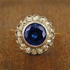 Vintage Sapphire Engagement Ring with Diamond Cluster. circa 1950