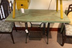 vintage singer sewing base with reclaimed redwood top.  Makes a great desk.