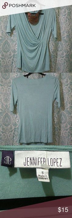 NWOT Jennifer Lopez knit Top This top is a wrap front and has a nice drape to it. Its lightweight and can be easy worn with any desired bottom. A necklace would top it off nicely. Jennifer Lopez Tops Blouses