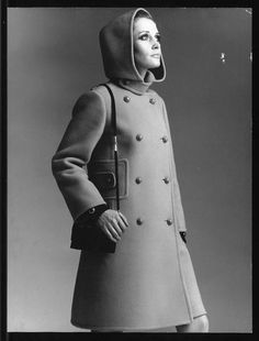 Core Record CollectionLondon College of Fashion: The Woolmark Company DesignerChristian Dior Fabric ManufacturerLesur Date1968 DescriptionDouble-breasted coat in a dark gold velvety worsted wool Woolmark fleece by Lesur. Matching ,martingale buttons in front and is outlined by wide inset. Welt seams - romantic hood - high side buttoned collar. Black suede and gold shoulder bag. Subjectwomenswear, coat