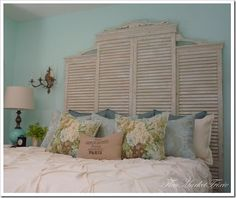 Headboard made from window shutters and with wood trim added