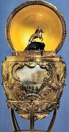 Peter the Great Egg, 1903. The surprise is that when the egg is opened, a mechanism within raises a miniature gold model of Peter the Great's monument on the Neva, resting on a base of sapphire.