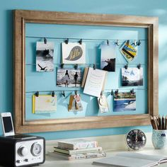 Frame a collection of hanging cards for an easy to update art collection.