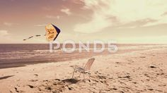 Video footage. Pond5.com. Chaise lounge on the beach, the sea and a kite.   #beach #time #background #ball #holiday #kite #word #sea #flying #sand #collection #shell #star #sun #lifebuoy #sky #fish #sunlight #decoration #chair #flop #shore #sunglasses #tropical #mesh #elements #umbrella #coral #title #sunshine #shape #season #rays #flipflop #realistic #flip #colorful #seashore #lounge #nature #vacation #editable #starfish #ocean #chaise lounge #color #day #summer  #Video #footage #stock…