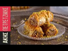 Saragli - Rolled baklava by Greek chef Akis Petretzikis. Traditional saragli rolls that are crunchy and syrupy with a pistachio, almond and walnut filling! Greek Sweets, Greek Desserts, Greek Recipes, Turkish Baklava, Greek Menu, Greek Pastries, Greece Food, Baklava Recipe, Desserts With Biscuits