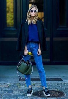 Working a head-to-toe colour palette, Tine Andrea teams her panel jeans with a fancy sweatshirt (check out the ruffle), a smart navy tailored coat and fresh-as flatform loafers. A bottle-green hobo bag is the perfect unexpected finish