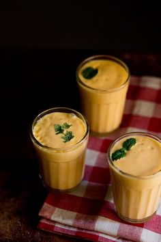mango lassi – thick and smooth lassi flavored with cardamom powder and saffron. have a refreshing mango lassi to keep you cool this summer.  #lassi #mangoes