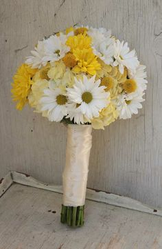 Bridal bouquet of yellow hydrangea with white and yellow daisy poms & craspedia. #YellowBridalBouquet #DaisyBridalBouquet